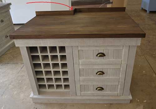 Custom made AA unit with wine rack and drawers to make space for a pillar in the kitchen.